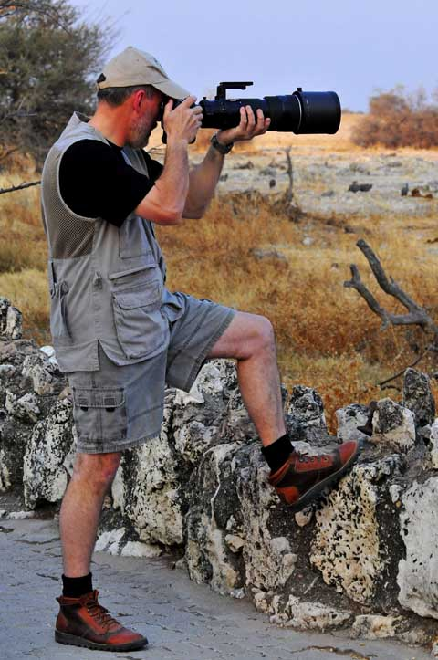 photographing at Okaukuejo waterhole in Etosha