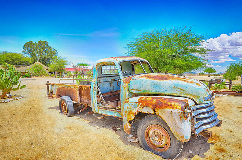 Old rusty desert car at Solitaire