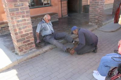 My boots being polished on the veranda of the supply store in Rietfontien.