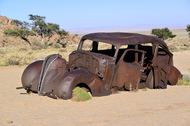 Old rusty Hudson riddled with bullet holes!