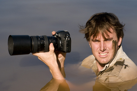 Greg du toit photographing from in the waterhole