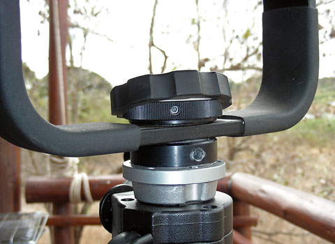 Manfrotto gimbal head showing holes